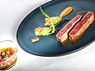 Wagyu beef with iodised juice and puntarelle,broth and slivers of smoked Wagyu.
