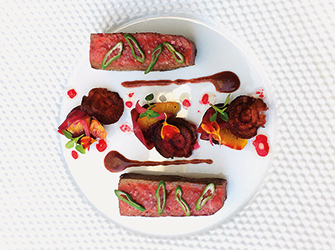 Glazed Wagyu beef piece, Alsacian pinot noir dreg sauce,beetroot and blood orange.
