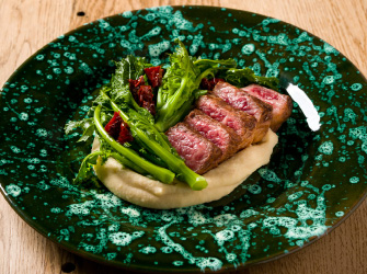 Japanese Wagyu with a broad bean and turnip greens cream