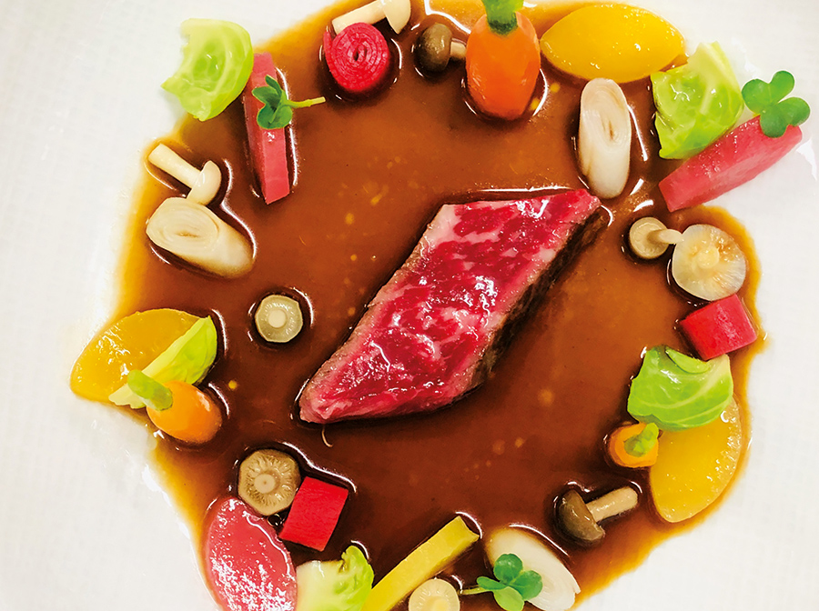 Wagyu beef cooked in a full-bodied consommé, raw and cooked vegetables