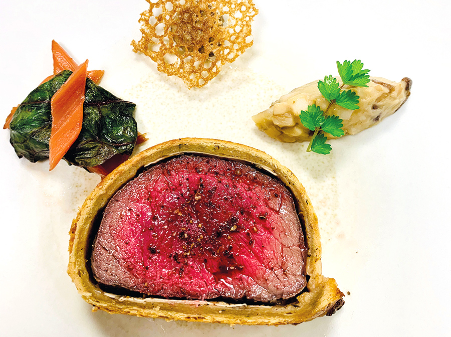 Wagyu rump steak in a Mélilot crust, chard gratin with beef broth and truffle