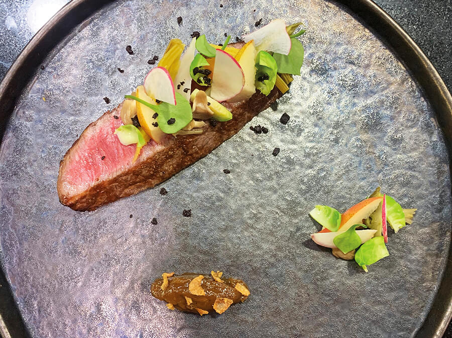 Piece of wagyu, briskly grilled - raw autumnal vegetables and fruits - with Savoyard onion condiment