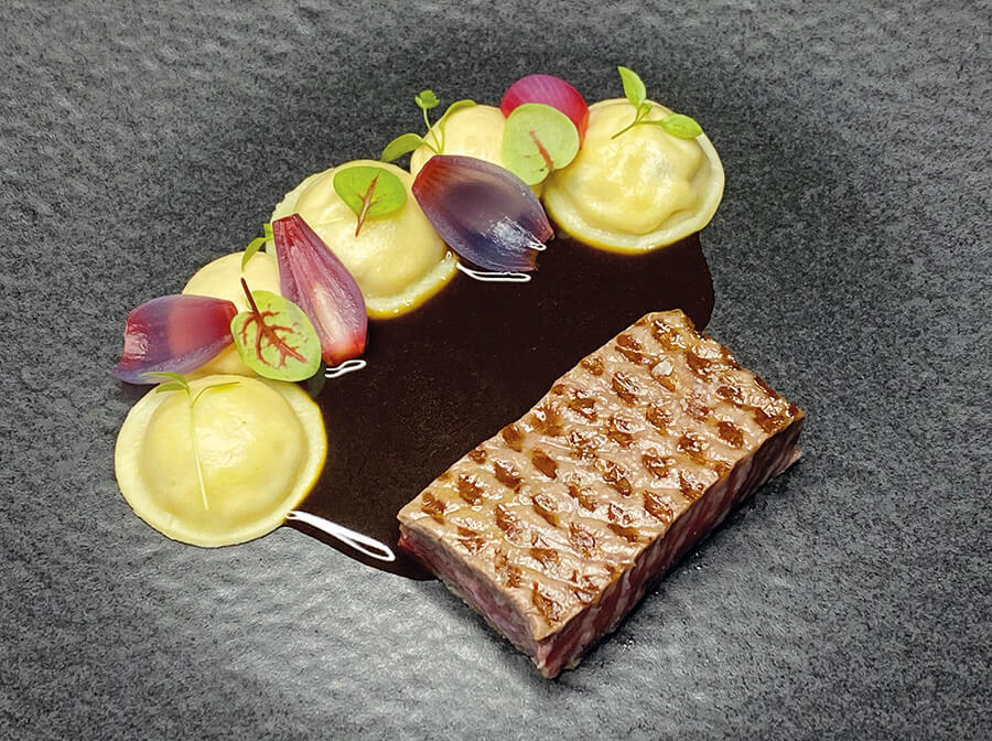 Grilled Japanese wagyu steak, served with a mousseline and ravioli filled with onions in vinegar, topped with sweet onion sauce