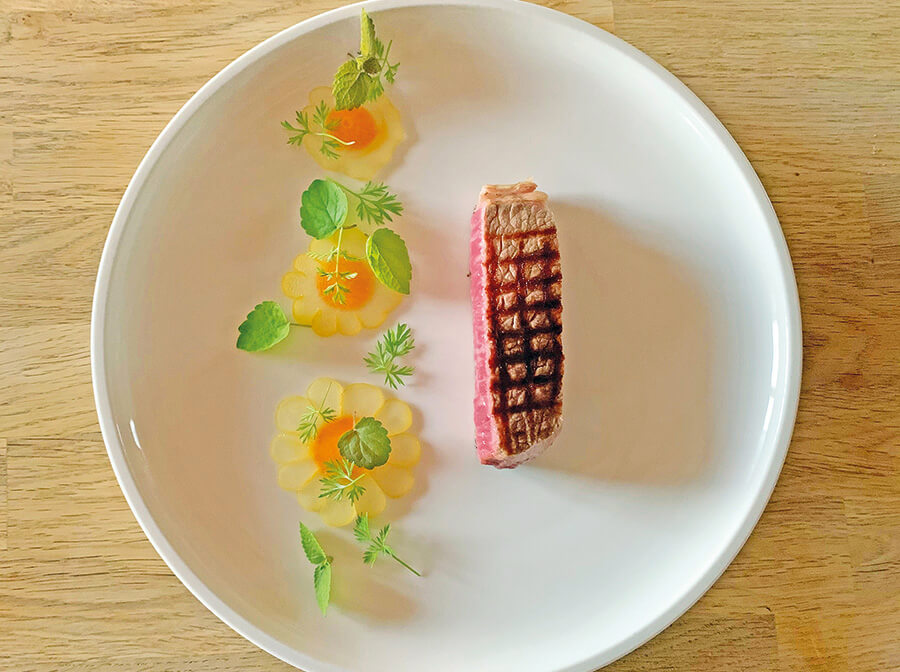 Wagyu beef smoked in sweet vernal grass, served with Buddha's hand citron ravioli, carrots and clementines