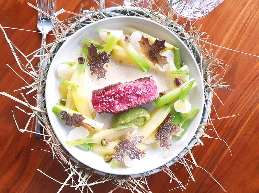 Wagyu beef, iodised pistachio pulp, white vegetable stew flavoured with hay and black truffle